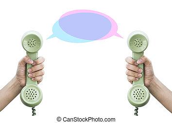 Communication. Hand hold retro telephone isolated on white backg
