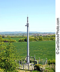 Radio communication mast in a fenced compound