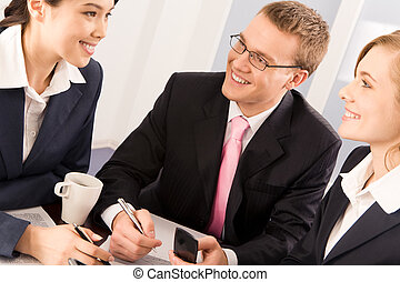 Communication - Portrait of business people communicating in...