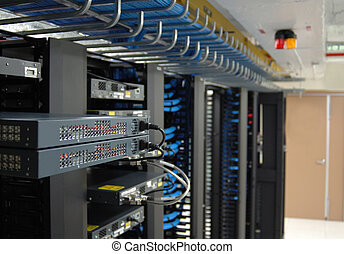 Communication racks in a datacenter filled with switches and...