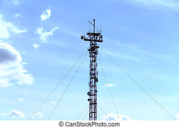 communication tower against the blue sky
