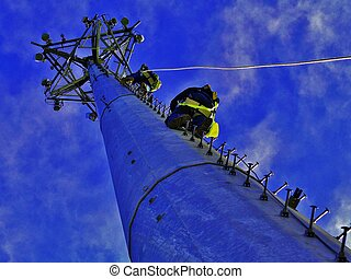Communication Tower Climb - Two Tower technicians climbing a...