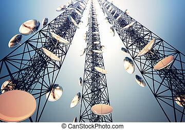 Communication towers. - Three tall telecommunication towers...