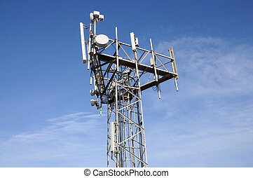 Communications antenna tower against blue sky