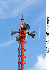 Communications antenna tower on blue sky