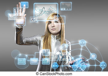 communications concept, young blonde with silver latex jumpsuit with digital tablet