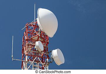 Communications Tower - A communications tower against blue...
