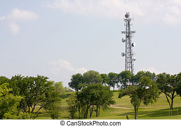 Communications Tower - A communications tower standing in a...