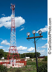 Communications tower against a blue sky