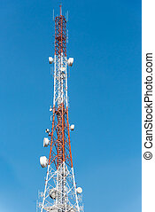 Communications tower with blue Cloud sky background.