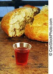 Communion Bread and Wine - Communion bread and wine on a...