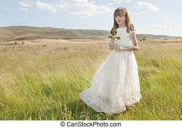communion girl - communion dress girl in the field