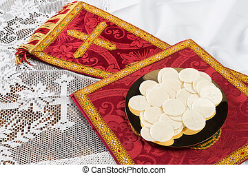 Communion hosts or wafers and vestment - Red vestment set...