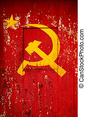 Communist Party symbol in a old wooden door with red paint ...