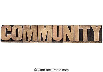 community word - isolated text in letterpress wood type