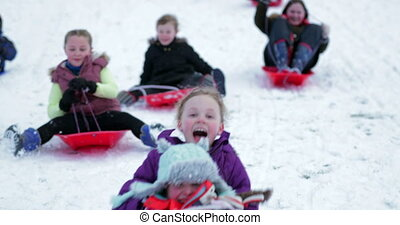 Community Sled Race - Children from the community ar having...