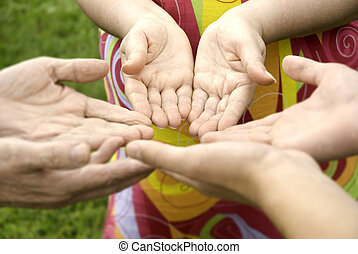 community - hands of the family (focus on hands of...