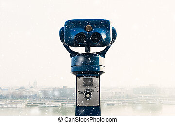 community telescope in a lookout, view onto the city,...