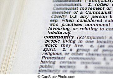 Community - The word volunteer community written in a...