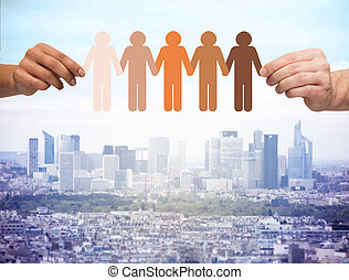 hands holding paper chain multiracial people