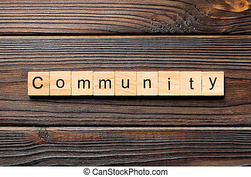 Community word written on wood block. Community text on wooden table for your desing, Top view concept
