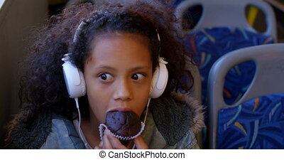 Commuter having muffin while travelling in bus 4k - Girl ...