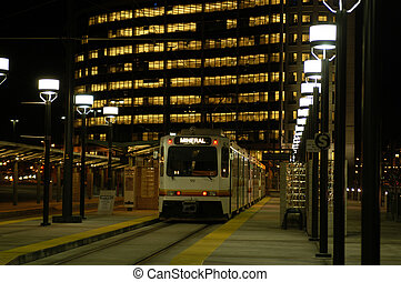 Commuter Train - A commuter train pulls away from a Downtown...