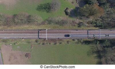 Commuter Train Crossing a Bridge - Aerial Shot of a commuter...