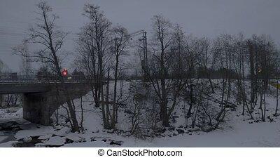Commuter train crossing the bridge in Helsinki. Winter scene