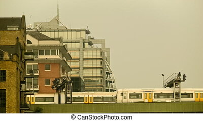 Commuter train passing by, London - Train passing from...