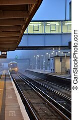 Commuter train pulling into station - A regional commuter...