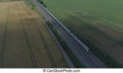 Commuter Train Speeding Through the Countryside