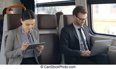 Commuter Train - Two strangers riding the commuter train...
