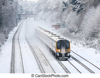 commuter train travelling in snow, UK