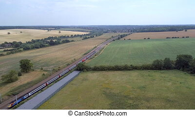 Commuter Train Travelling Through the Countryside in Summer...