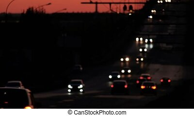 Commuters on they way home, blurred cars on freeway in night...