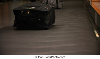 Commuters picking their luggage from baggage claim area 4k -...
