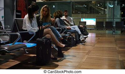 Commuters waiting in waiting area 4k - Commuters waiting in...