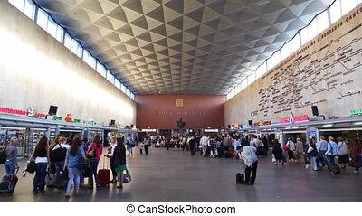 Commuters walk in railway station Moskovskaya. -...