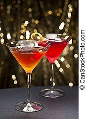 Comopolitan and Manhattan cocktail nice garnished with gold glitter back ground