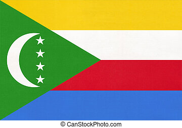 Comores island national fabric flag, textile background. Symbol of international world African country.