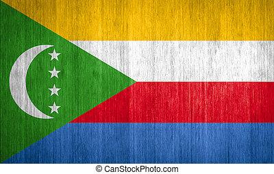 Comoros Flag on wood background
