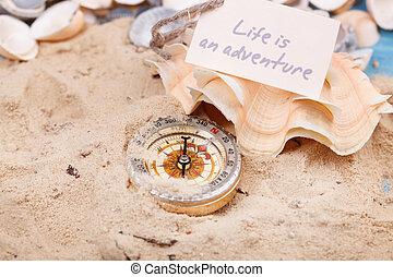 compás, en la arena, con, mensaje, -, vida, es, un, aventura