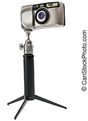 Compact camera - compact camera on a tripod isolated on ...