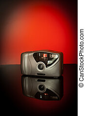compact camera - Compact camera photographed on a table in a...