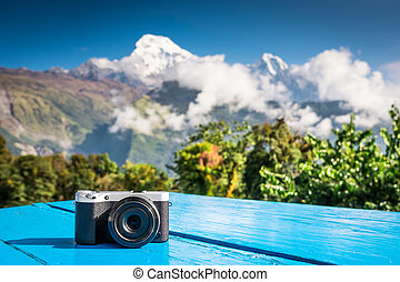 Compact digital camera in front of beautiful mountain view, Anna