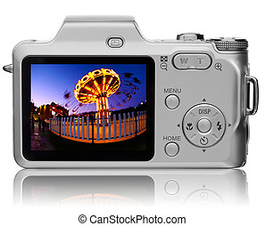 Rear view of compact digital camera with vivid picture on it's diplay
