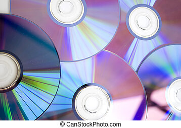 compact disks - pile of few compact discs