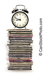 Compact disks with alarm clock - Pile of compact disks with...