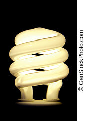 Compact flourescent light bulb with copy space on black background